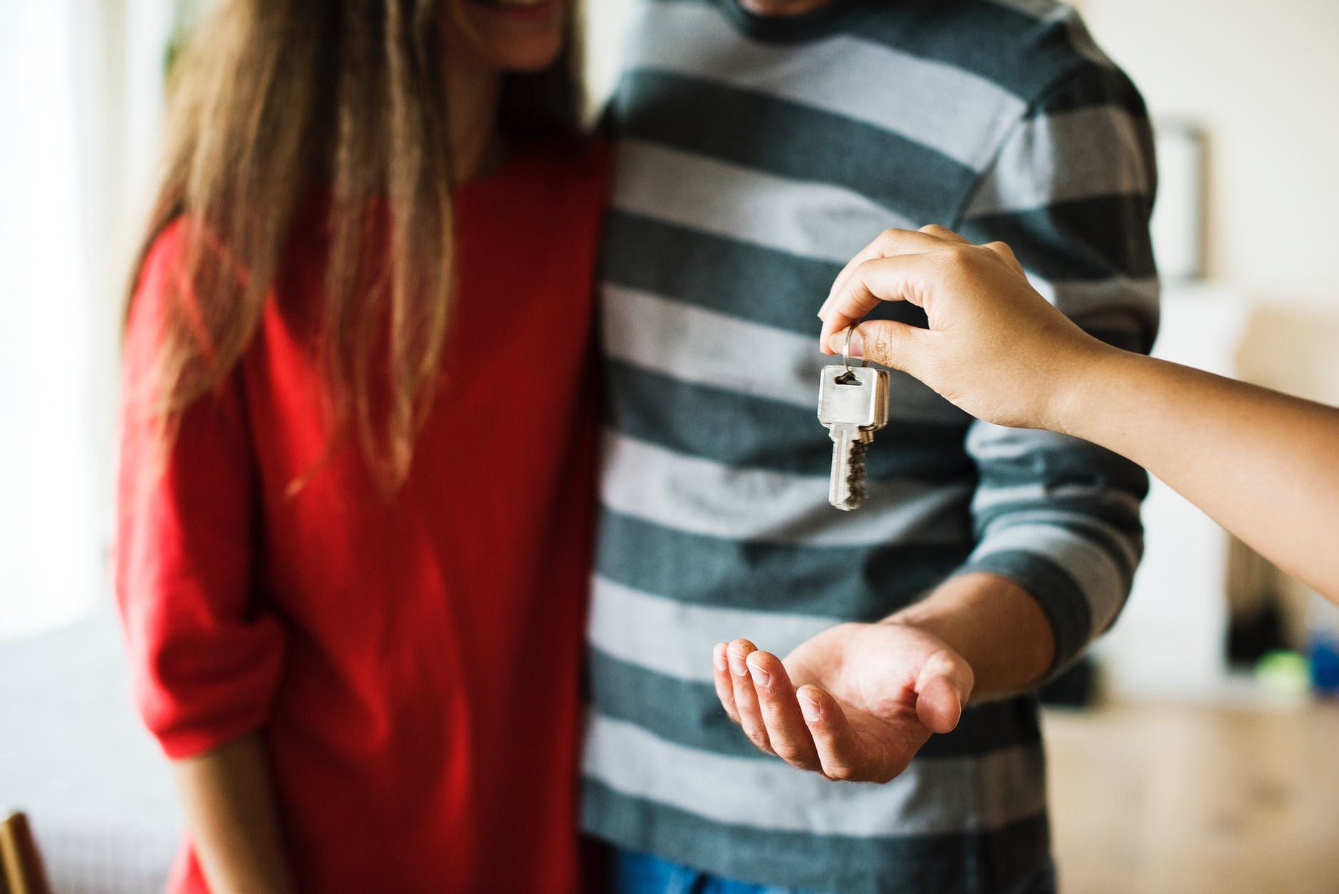 Couple Getting Keys to Foreclosed House